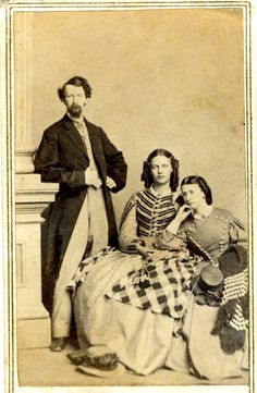 This rare carte de viste albumen print is by R.S. Delamater. The subject matter is two women in confederate uniforms flanked by a gentleman. What is most interesting is the subject matter - southern aristocracy - women in confederate uniforms- photographed by a well known union photographer.