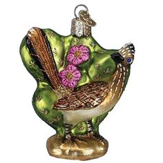 """Roadrunner Ornament 16074 Merck Family Old World Christmas **Introduced 2012* Ornament measures approximately 3 1/2"""" Made of mouth blown, hand painted glass The"""