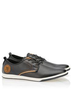 Seventy Five sneakers, available via www.namshi.com
