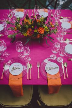 fuchsia and orange reception table, photo by Mel Nocks Photography http://ruffledblog.com/whimsical-greenville-wedding #weddingideas