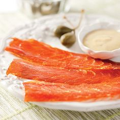 It's all in the smoke.  The double-smoked salmon, cured with maple, is intensely rich and incredibly good.  Made the old-fashioned way in a Maine smokehouse, this is bacon done right, only with salmon.  A truly unique delight, we guarantee it!