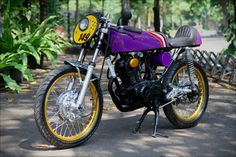 1974 Honda CB125. Funky colors but looks great nonetheless. Must read the article about how they ended up painting it purple...