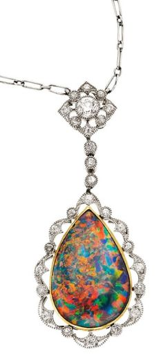 Edwardian Black Opal, Diamond, Platinum, Gold Necklace, J.E. Caldwell & Co. The necklace features a pear-shaped black opal cabochon measuring 18.00 x 12.00 x 4.70 mm, set in gold, enhanced by European and full-cut diamonds weighing a total of approximately 0.45 carat, set in platinum, marked JEC & Co. for J.E. Caldwell & Co. Gross weight 6.38 grams. Pendant Dimensions: 1-5/8 inches x 11/16 inch Chain Length: 15 inches. Listed at Heritage Auctions, via Stonefinder.