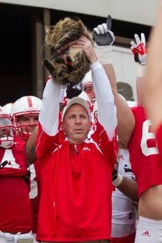 A coach and his cat-Nebraska spring game.  I was at the spring game and this was epic!