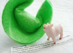 There is a little good luck pig in this Fortune cookie.    In Germany, pigs are used to represent good luck.