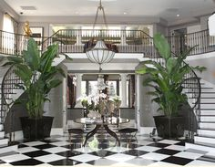 The Front Foyer of the Jenner home: Black and white tiles with greenery... Very Resort-Like