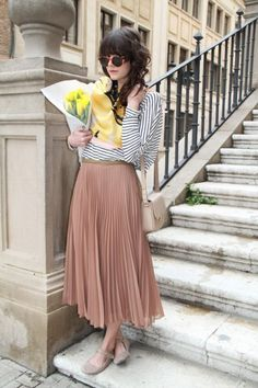 Wear a nude tone pleated maxi with a striped top yellow flowers, midi skirts, fashion, outfit, long skirts, summer clothes, stripe, curly hair, maxi skirts