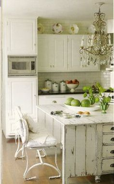 Love the distressed wood! White kitchen