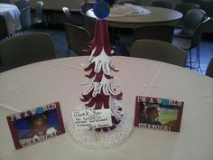 Fundraiser centerpiece. Child hand cutouts hot glued to styrofoam cone to make the tree. Careers are written on the fingers. Our school is the Gilcrease Elementary World Changers.