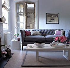 gray tufted sofa love