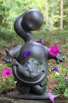 Garden statues on pinterest garden statues statues and garden angels for Alice in wonderland garden statues