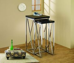 High Gloss Black Two Piece Tall Nesting Table Set with Chrome Base and Decorative Cross Bars by Coast. $144.99. Accentuate your living room with a modern twist. This two piece nesting table set features smooth high gloss black table tops and a stunning chrome base with decorative cross bars.  NESTING TABLE (L)13.25 x 13.25 x 29  NESTING TABLE (S)10 x 10 x 25