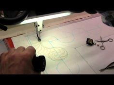 Awesome video...free.  Jamie Wallen marks and then sews the Curling Amish Feather.  This Design and more can be found on the 5 Disc set, ThreadFusion1 available at www.jamiewallenst....