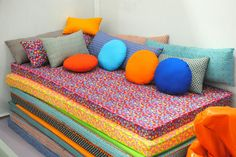Fabric covered foam stacked for a couch and pulled apart for sleepovers. this would be so great in a play room!!