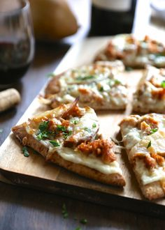 white chicken naan pizza with sauteed pears and gorgonzola.