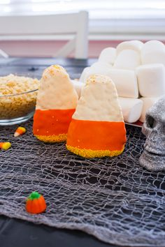 Melt 1/4 cup butter over medium heat and add 10 oz. of marshmallows. Stir until melted. Remove from heat and add cereal, mix well. Pour into baking dish and mold into the shape of candy corn. Let cool. Decorate with white and orange icing and sprinkles for another sweet, and larger, variety of a Halloween staple.