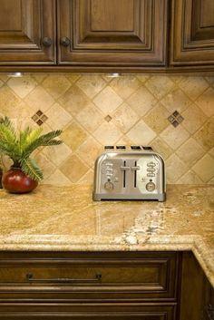tile backsplash; cabinets; counter