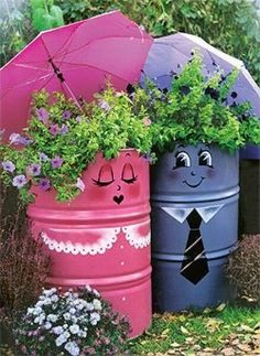 These are absolutely adorable. Great use of old 44 gallon drums.  This #landscape object is determine to make you smile. ~ Check this out too, BlueSkyRain.com #Sprinklers #Lighting #Landscape #Garden #Flowers