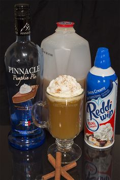 Thanksgiving in a Glass - pumpkin pie vodka, spiced apple cider, nutmeg, cinnamon sticks, and whipped cream.