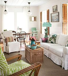 love all the texture, slipcovers, pendants, shutters.