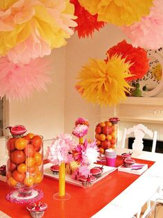 Love these DIY tissue paper pom poms for a girl's birthday party!