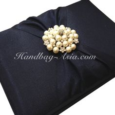 Black wedding invitation box in 5x7x1 inches with large pearl brooch.