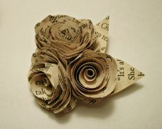 antique book pages made into flowers would be a nice topper to a stack of old books