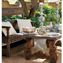 Mesquite furnishings set the stage for alfresco dining in the front courtyard. The silver pieces are family heirlooms.
