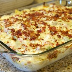 Chicken Ranch Pasta  1 lb. bacon, fried and crumbled, grease saved 2 lb. boneless, skinless chicken thighs 2 tablespoons of ranch seasoning 1 bell pepper, diced 2 clove garlic, minced 1 lb. bow tie pasta, cooked al dente 2 jars of Alfredo sauce 1/3 cup of evaporated milk or regular milk 3 roma tomatoes, diced 4 cups shredded Italian cheese blend