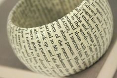 This book bracelet, made from wood and decoupaged text, captures the final words of Charlotte Bronte's classic novel, Jane Eyre.