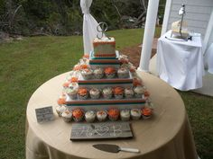 coral and teal cupcake wedding cake beach