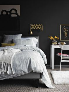 Really into the idea of dark bedroom walls right now. Perhaps a deep blue or charcoal gray?