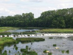 The widest rapid and waterfall in Europe, located on the Venta River in Kuldiga, Latvia.