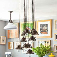 Make a statement with a single dramatic pendant fixture like this  Europa 8-bulb bronze multilight pendant, about $190; lampsplus.com; wire cage shade, about $15; shadesoflight.com | Photo: Lisa Romerein/Otto