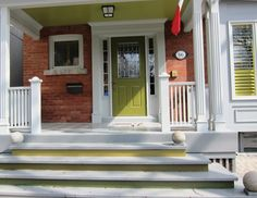 Bold color on front door matches porch risers  and porch ceiling adding an unexpected pop!