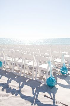 Blue lanterns as aisle decor for a beach wedding. Like!