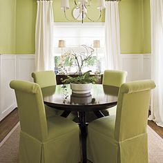 Make a Small Dining Room Look Larger,  Visually expand a small dining room by keeping the palette monochromatic and furnishing it with a round table and armless dining chairs. This crisp green dining room feels airy and open even though the space is small.