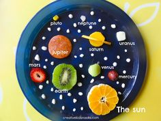solar system snack plate: Mercury: a red grape; Venus: celery; Earth: kiwi; Mars: strawberry; Jupiter: pepperoni; Saturn: cheddar cheese; Uranus: a slice of string cheese; Neptune: ham; Pluto: (No longer technically a planet) corn