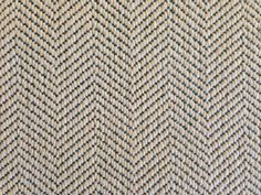 This is a wool carpet remnant with a herringbone pattern. www.thecarpetworkroom.com