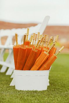 Umbrellas for guest, make your guests more comfortable in the sun.  Summer Wedding Ideas by Belle The Magazine