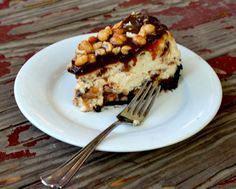 Homemade Snickers Bar Cheesecake with chocolate, caramel, and peanuts.|restlesschipotle.com