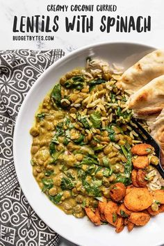 These rich, creamy, and earthy Coconut Curry Lentils are an easy and delicious vegan option for dinner or weekly meal prep! BudgetBytes.com #vegan #lentils