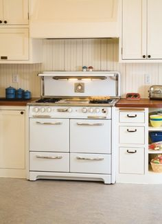 """♥ this antique Wedgewood stove!  from """"Kitchen Makeover for Century-old Home"""" at www.countrywomanmagazine.com"""
