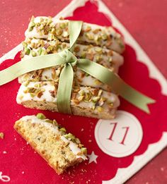 Pistachio nuts add crunch to these little cookies. White chocolate drizzled on top of the biscotti adds extra sweetness.