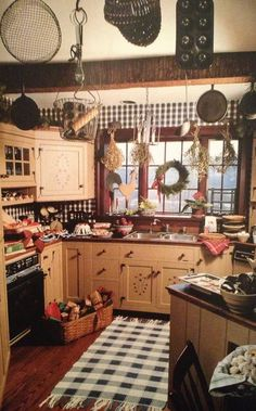 Prim Kitchen...love the checked rug & wall treatment.