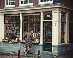 Corner Bookstore #shop #white #blue #cream #window #display #bicycle