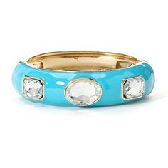 Dazzle with this spectacular hinge-bracelet. Large oval and square rhinestones encircle the shiny bangle.