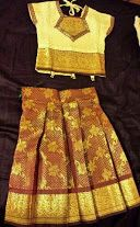 Traditional design art #silk material cream & maroon color #PattuPavada for 1 year old girls. This dress is very easy to wear and cost is also within budget.