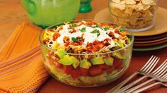 Mexican BLT salad (Hidden Valley)  ½ cup Hidden Valley® Original Ranch® Dressing  ½ cup Mexican-blend finely shredded cheese  ½ cup mild salsa  2 cups crushed corn chips  2 medium ripe avocados, peeled, seeded and diced  3 medium tomatoes, stems removed, seeded and diced  4 cups shredded iceberg lettuce  4 strips crisp-cooked bacon, crumbled