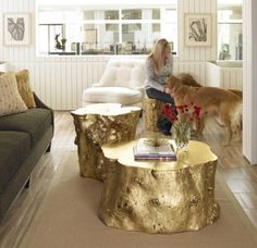 Spray painted tree trunk as a coffee table